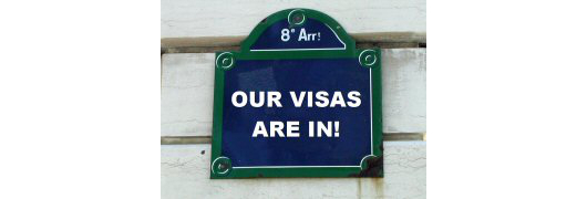 "Paris street sign saying ""Our visas are in!"""