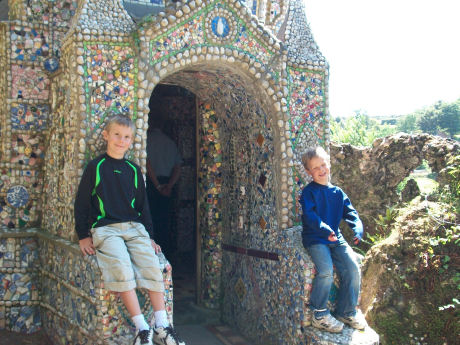 Posing in front of Guernsey's little ceramic chapel