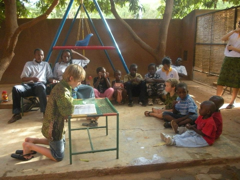 Silas reading a Bible story to the children.
