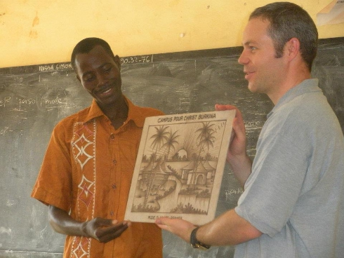 Dan receiving a gift from the local campus ministry in Ouagadougou