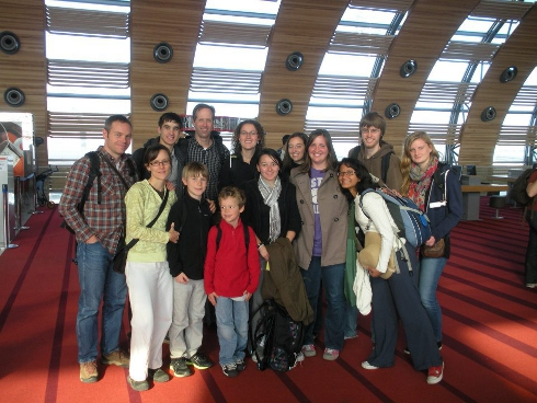 Team posing in the Paris airport