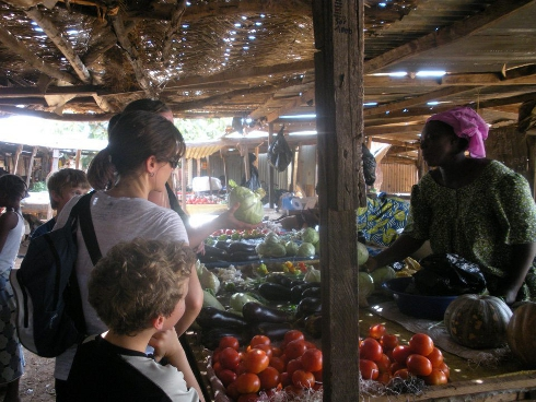 buying vegetables at the market in Africa